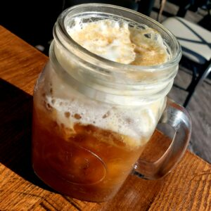 mason jar filled with cold brew coffee and cream