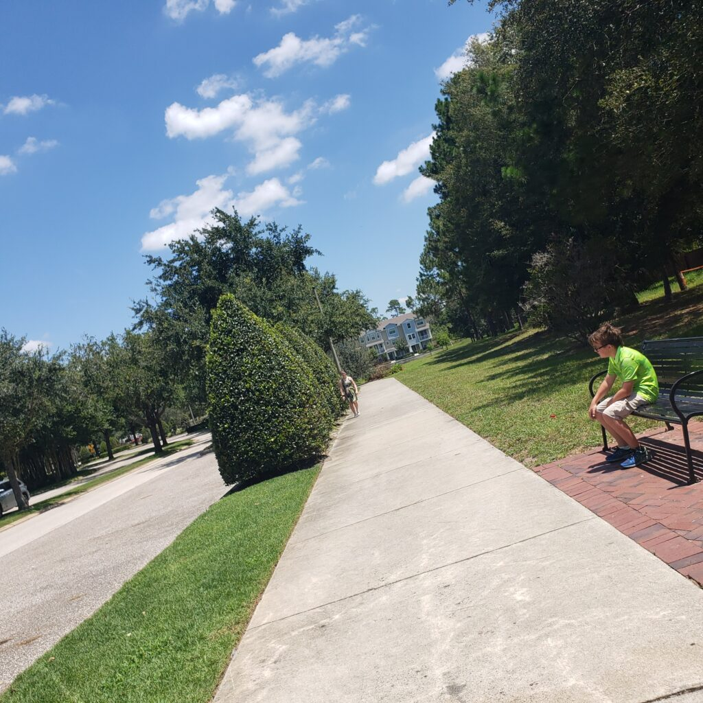 sidewalk blue sky kid sitting on bench fitness back mon track