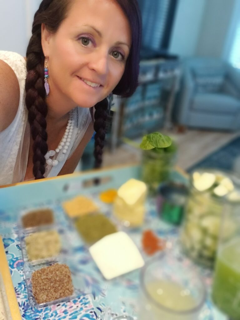 woman leaned over a plate of spices for a juice