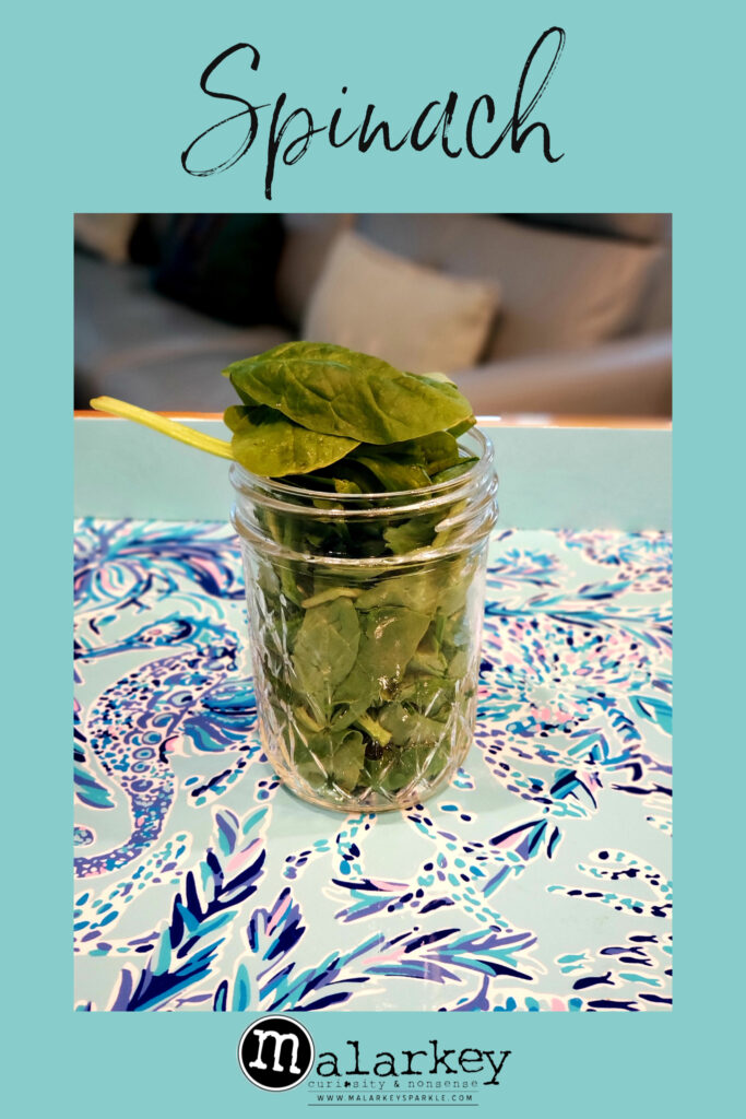 spinach in a jar on a plate