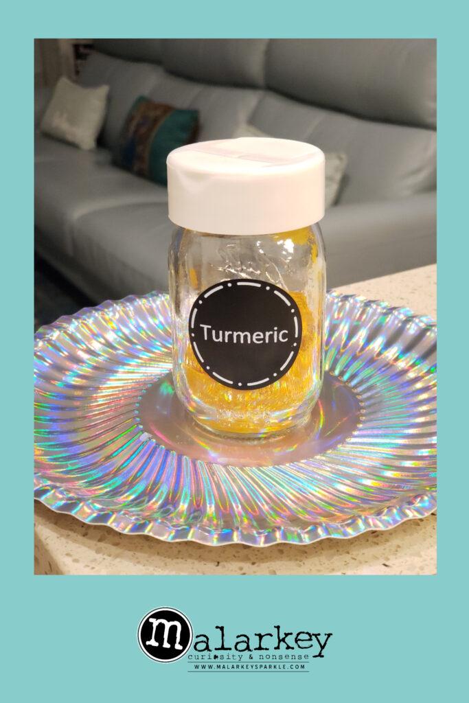 turmeric in a jar on a plate
