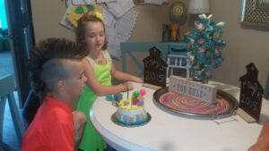 boy with mohawk in front of cake