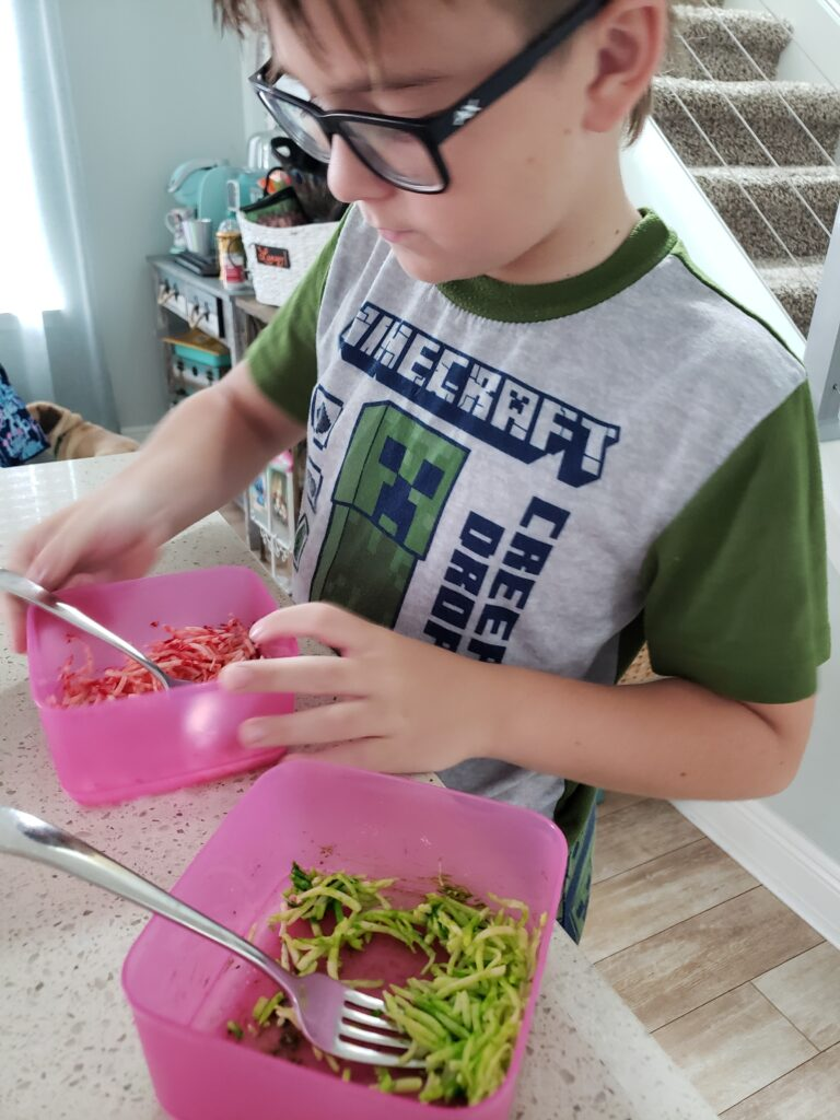 the boy coloring cheese with food coloring
