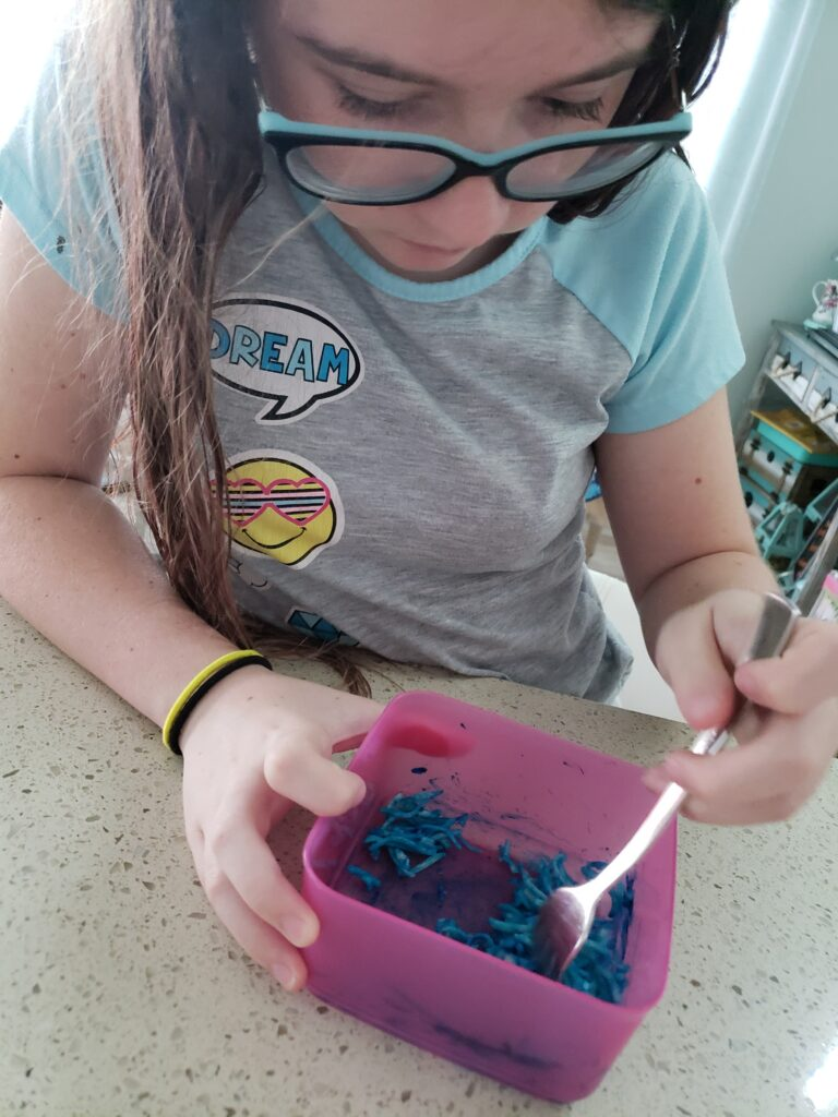 the girl coloring cheese with food coloring