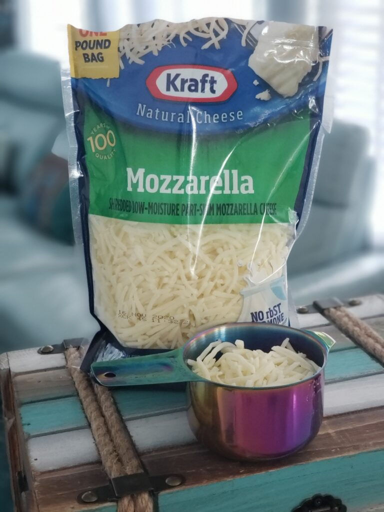 mozzarelle cheese and a measuring cup