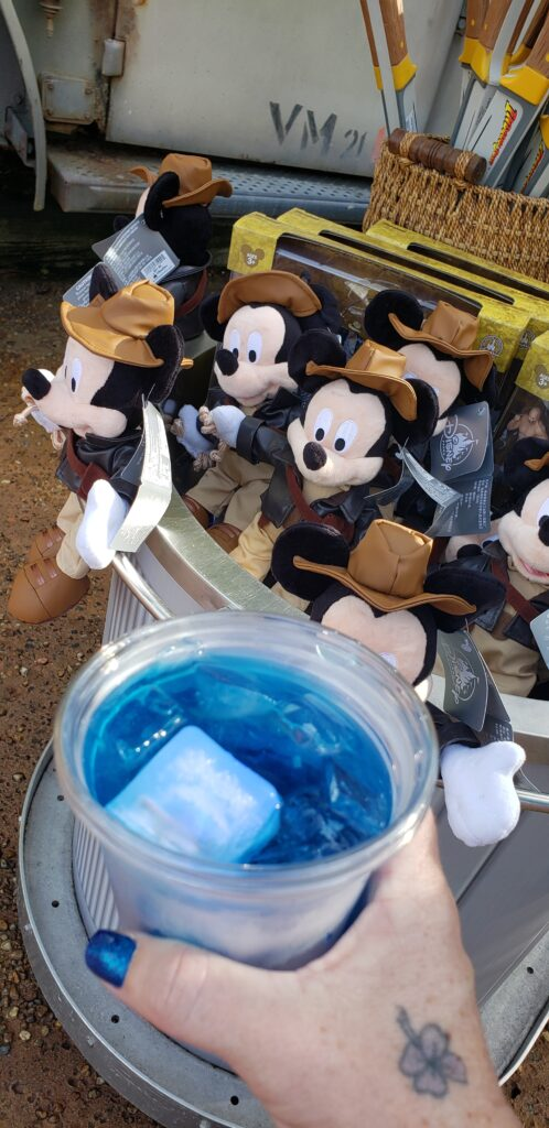 indiana jones swag at a cart in hollywood studios woman holding blue drink
