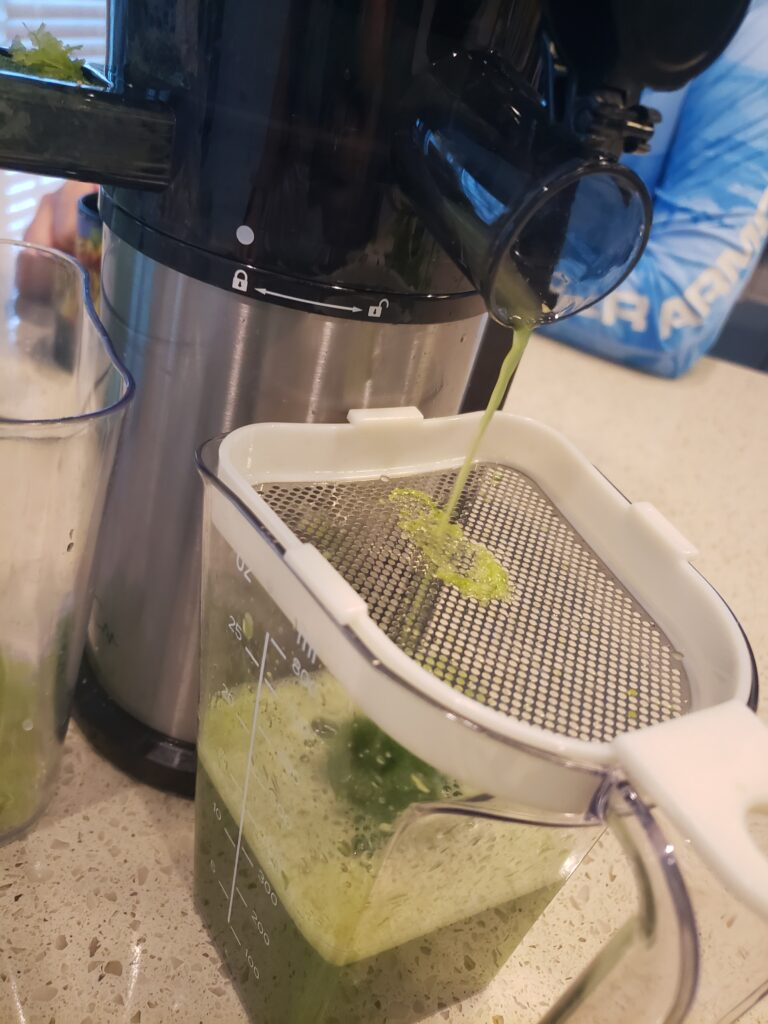 blender with juice inside and powers