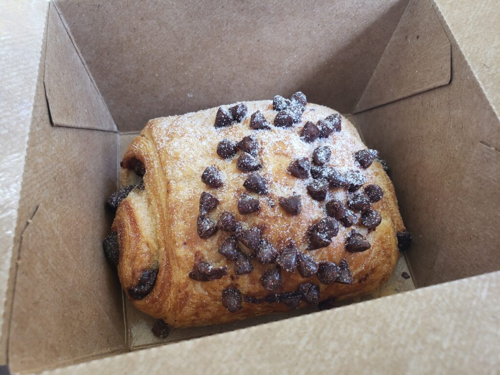chocolate croissant in a brown box