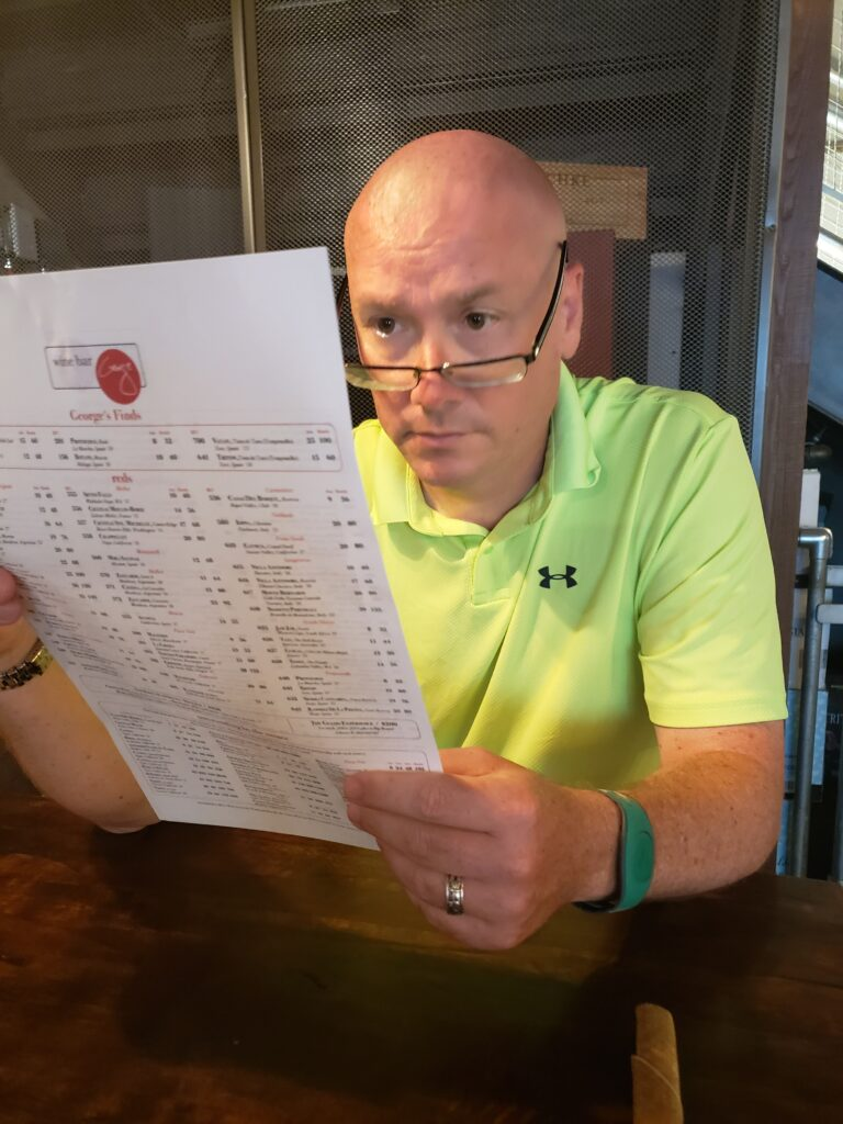 mark looking at menu at wine bar george