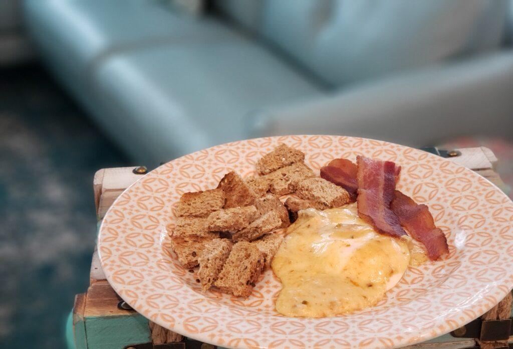 egg, toast, bacon on a plate