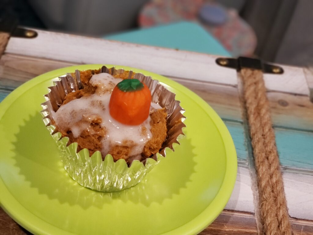 pumpkin muffin on a green plate
