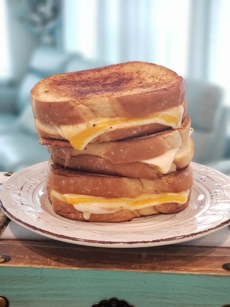 grilled cheese on a white plate - 3 stacked up