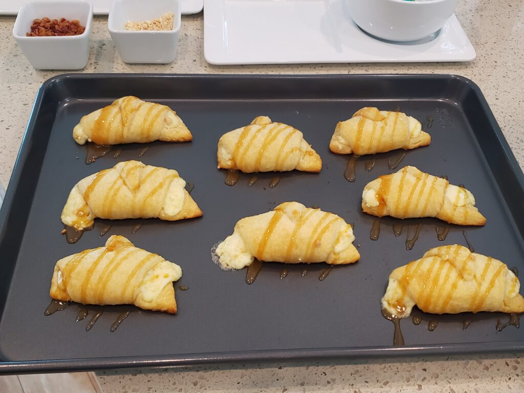crescent rolls on a pan with caramel