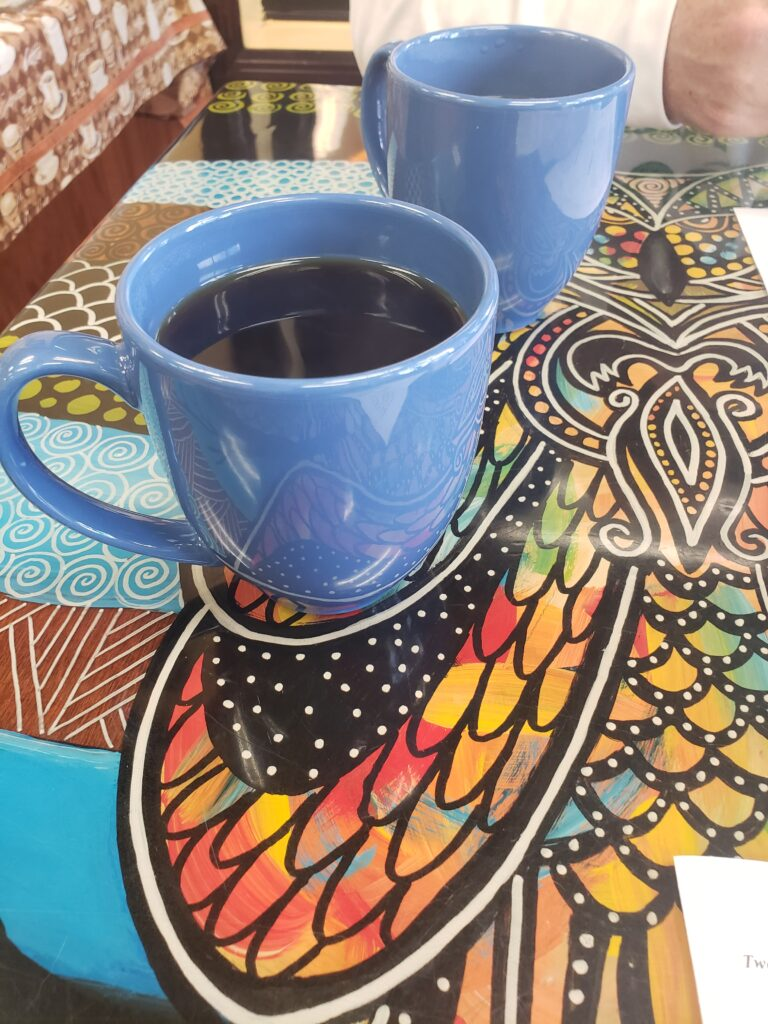 coffee in a blue mug on a colorful table