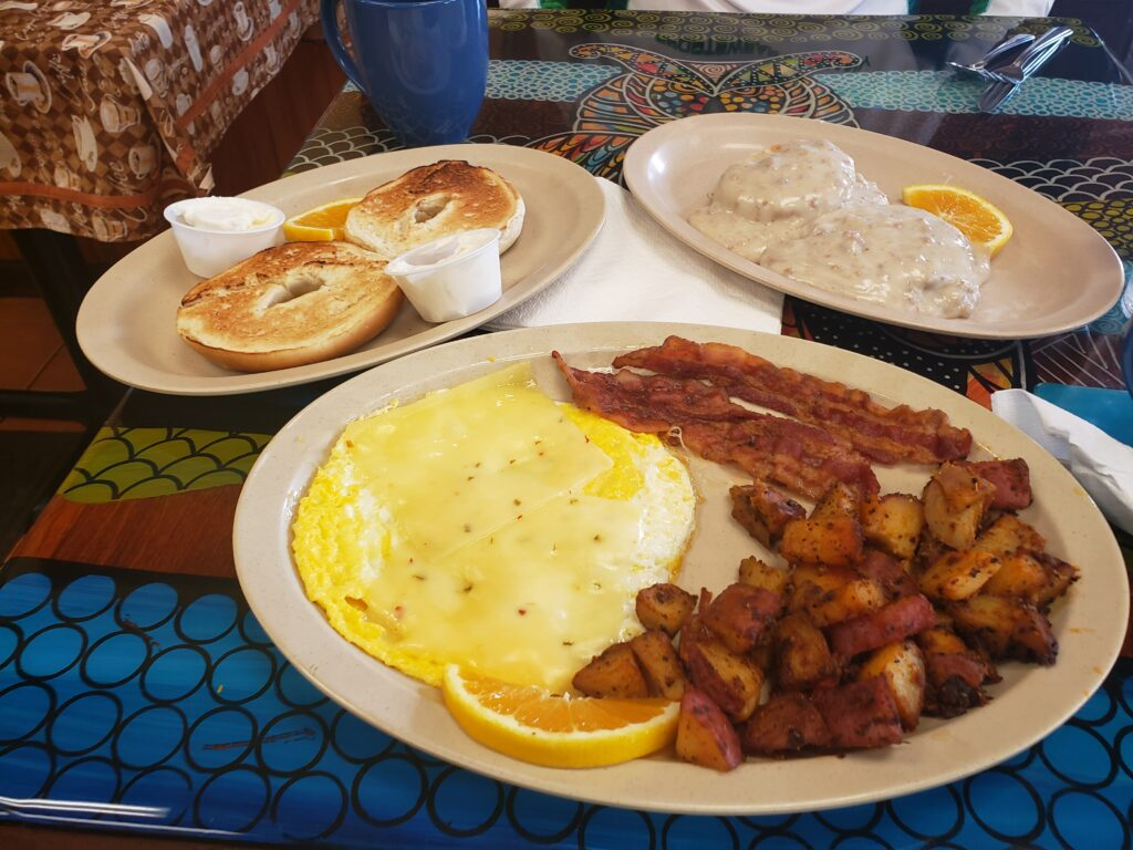 plate with breakfast on it on a table - eggs and such