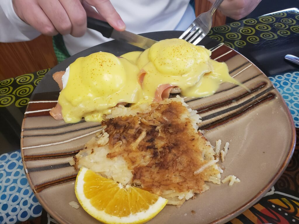 eggs benedict with hasbrown on a plate