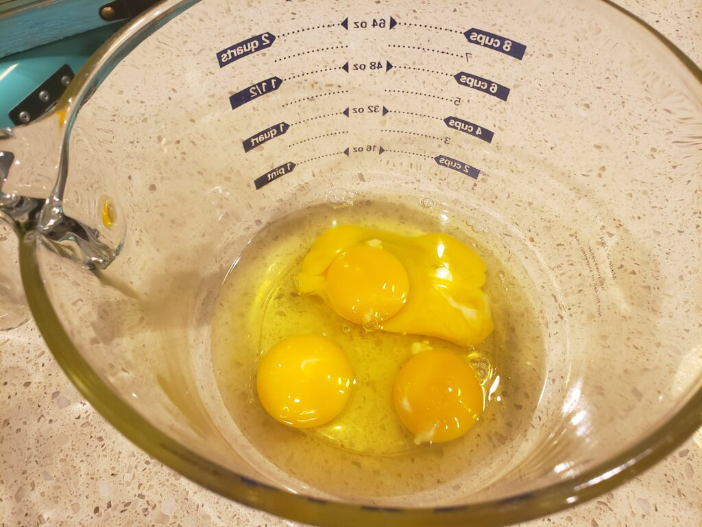 eggs cracked but not beaten in a bowl