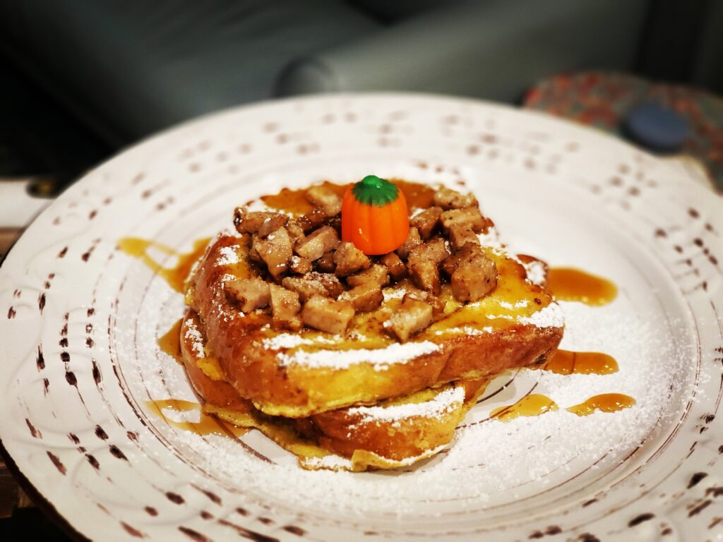 french toast on a plate with a pumpkin candy on top