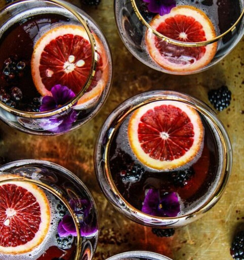 blood oranges floating at the top of a glass
