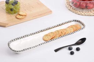 white and silver cracker dish