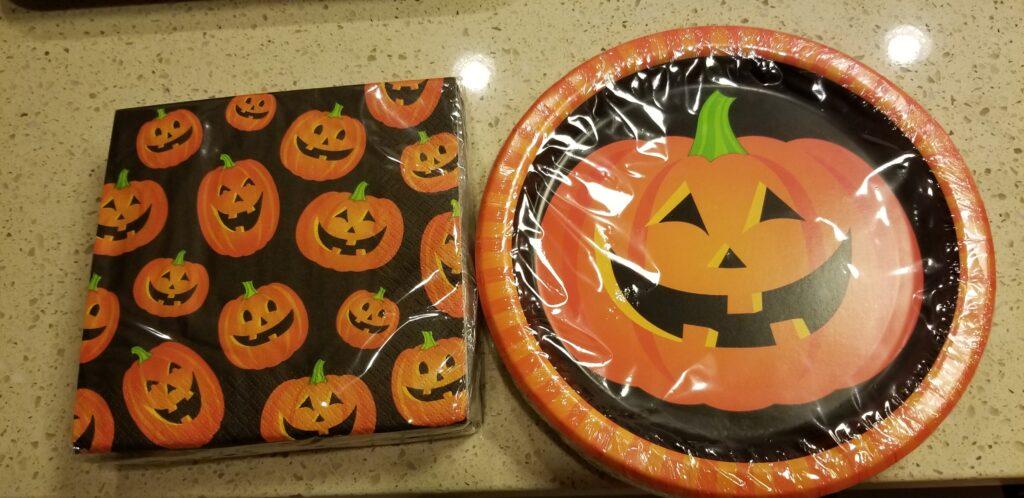 pumpkin plates and pumpkin napkins on a counter