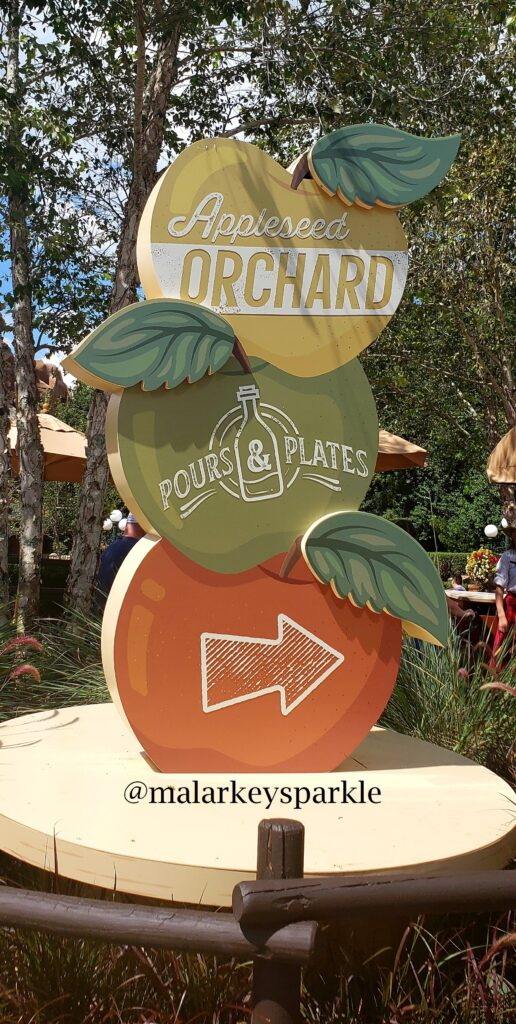 apple orchard sign at epcot