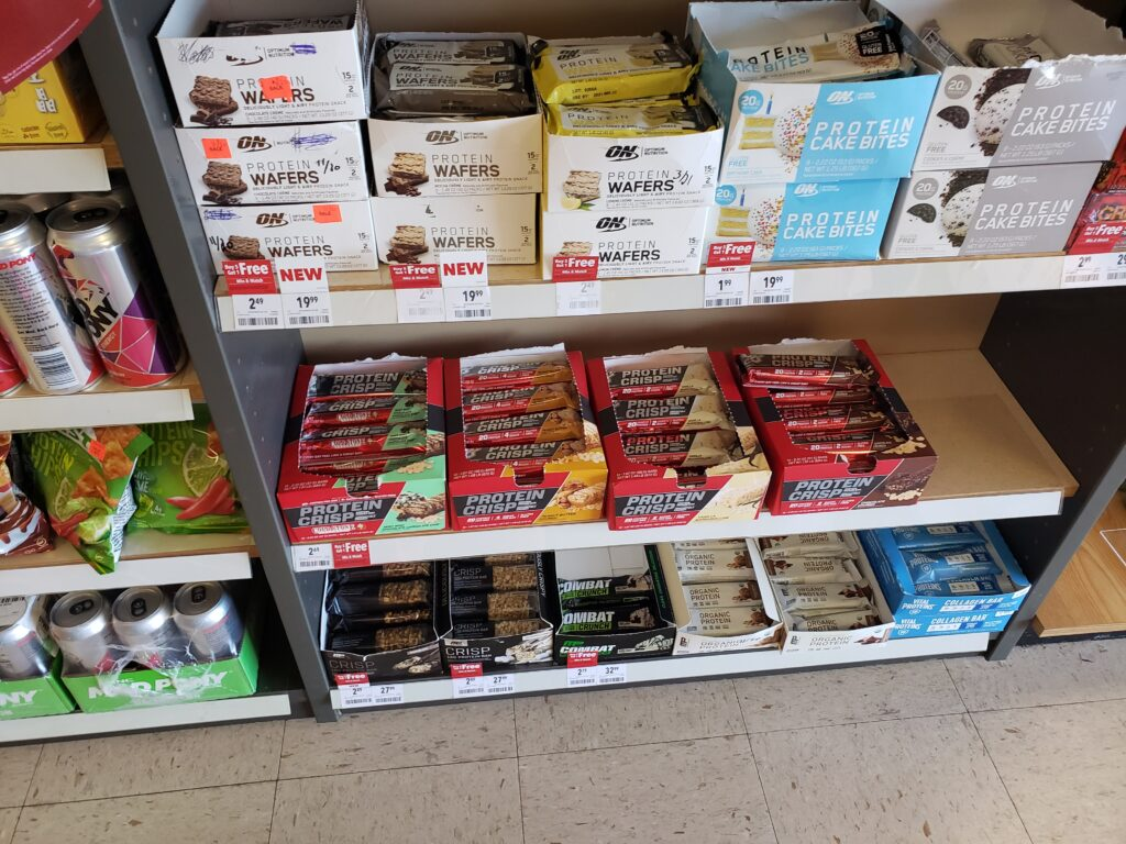 protein bars on the shelf at gnc