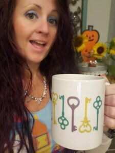 woman and a cup with keys on it