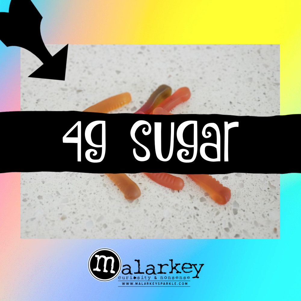 candy with a banner 4g of sugar over it