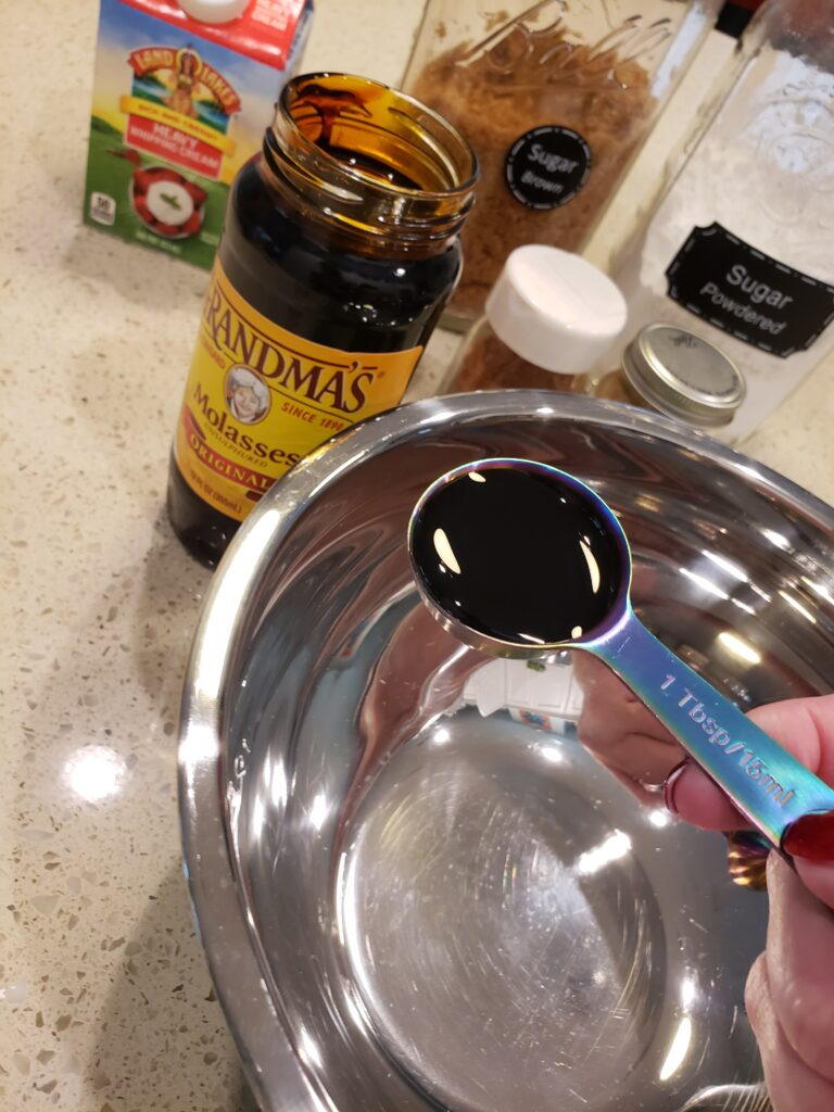 a bowl with molasses being poured into it to make The best french toast