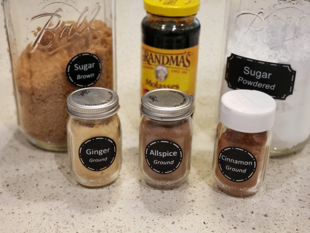 6 ingredients - on a counter - all spice - cinnamon ginger molasses - suger (brown) and powdered sugar these help to make The best french toast