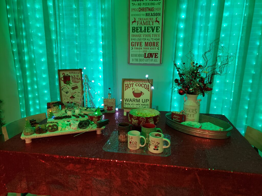 HOT COCOA CHARCUTERIE BOARD - table set up with green lights in the back
