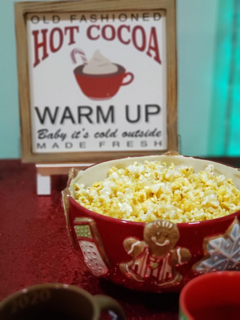 HOT COCOA CHARCUTERIE BOARD - popcorn and hot cocoa sign